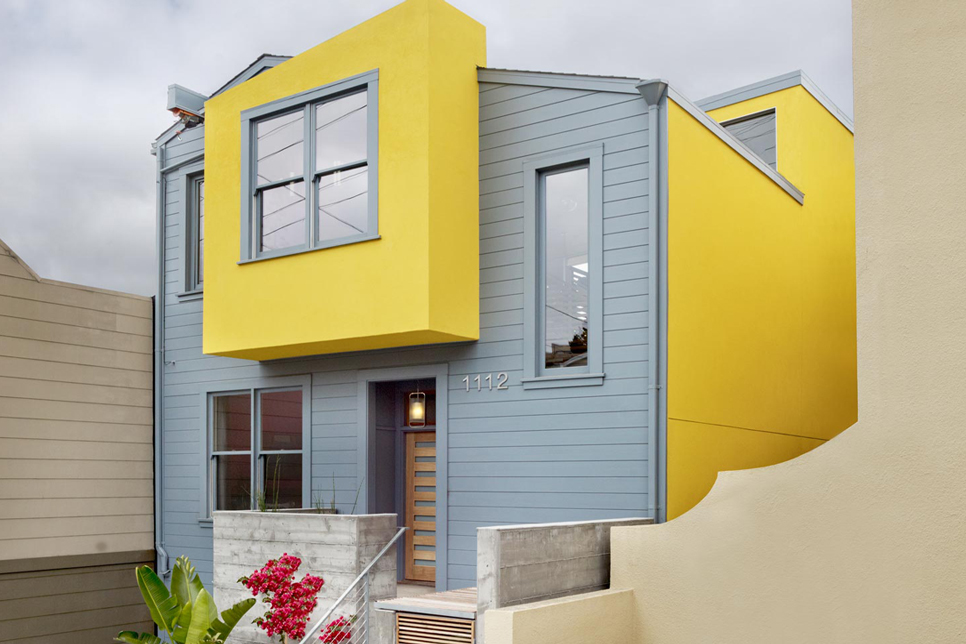 To Subdue The Tone, A Soft Gray Covers Most Of The Front Exterior, While  The Yellow Is Present In Smaller Doses.